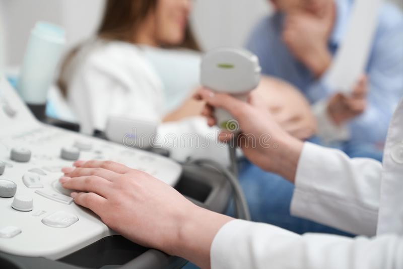 Ultrasound machine close up, diagnosis of pregnant woman. stock images