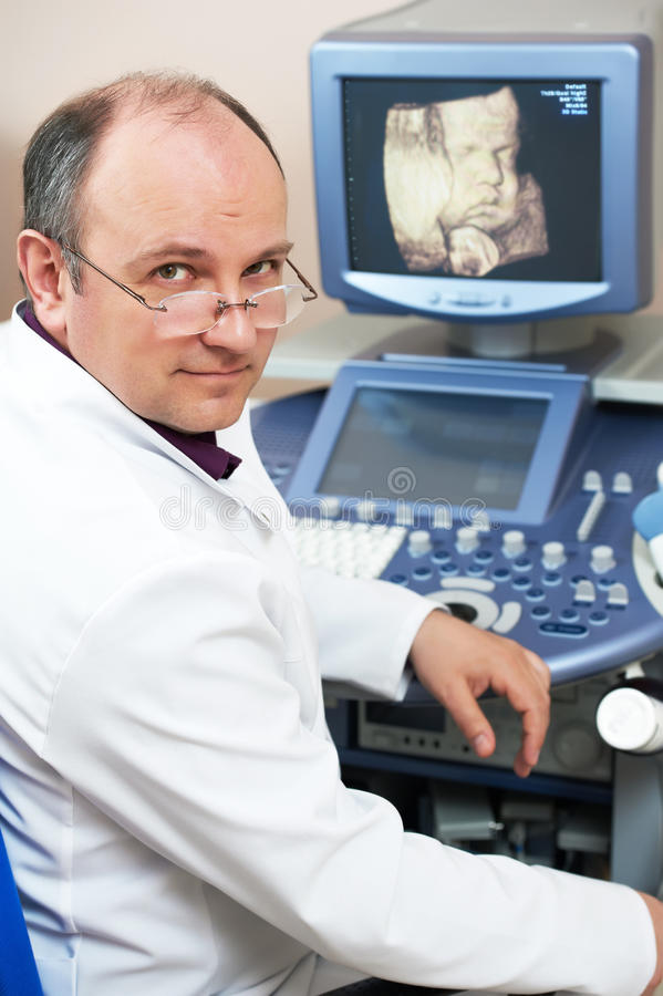 Ultrasound medical doctor. Male doctor with ultrasonic equipment during ultrasound medical examination stock images
