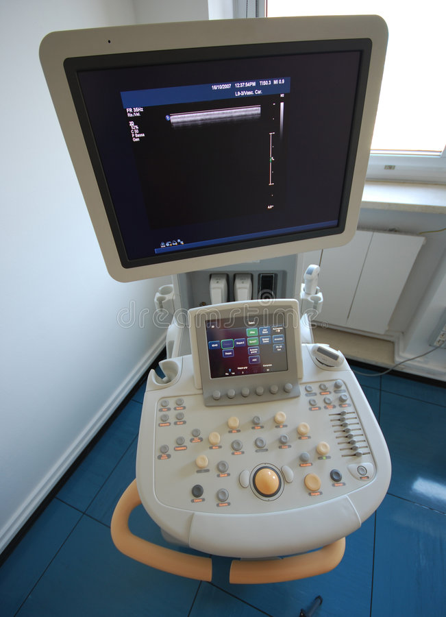 Ultrasound scanner. Medical instrument - The close-up of modern ultrasound scanner at the hospital. Ultrasound scanner with monitor stock photography