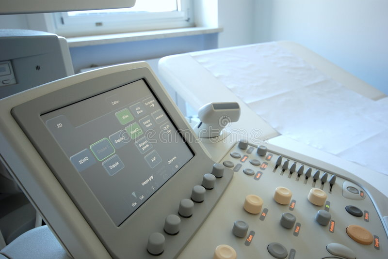 Ultrasound scanner. Medical instrument - The close-up of modern ultrasound scanner at the hospital. Ultrasound scanner with monitor stock image