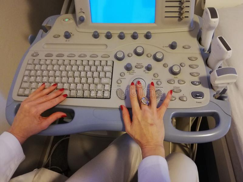 Ultrasound scanner in the hands of a doctor royalty free stock image