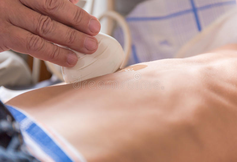 Ultrasound scanning. Of the internal organs to a little boy stock image