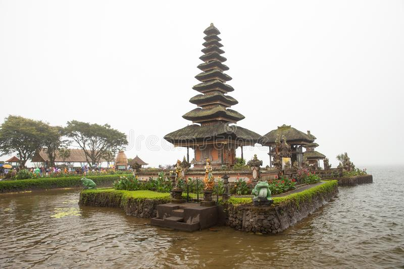 Ulun Danu Beratan Temple. In heavy rain and mist, tour in nasty weather could be interesting stock images