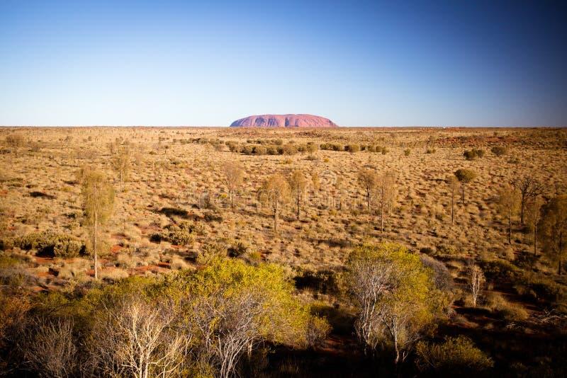 Uluru на заходе солнца стоковые изображения