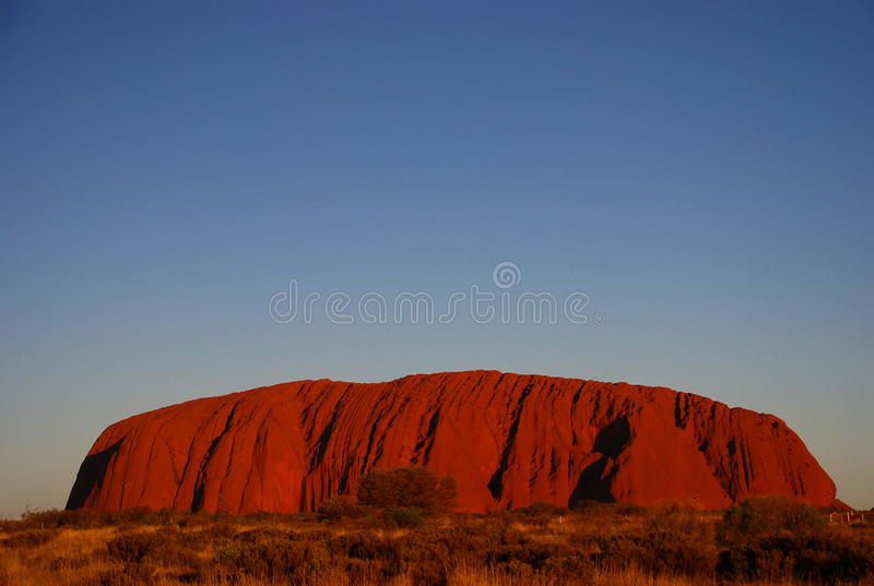 Uluru (утес Ayers) на заходе солнца территория Австралии северная стоковая фотография
