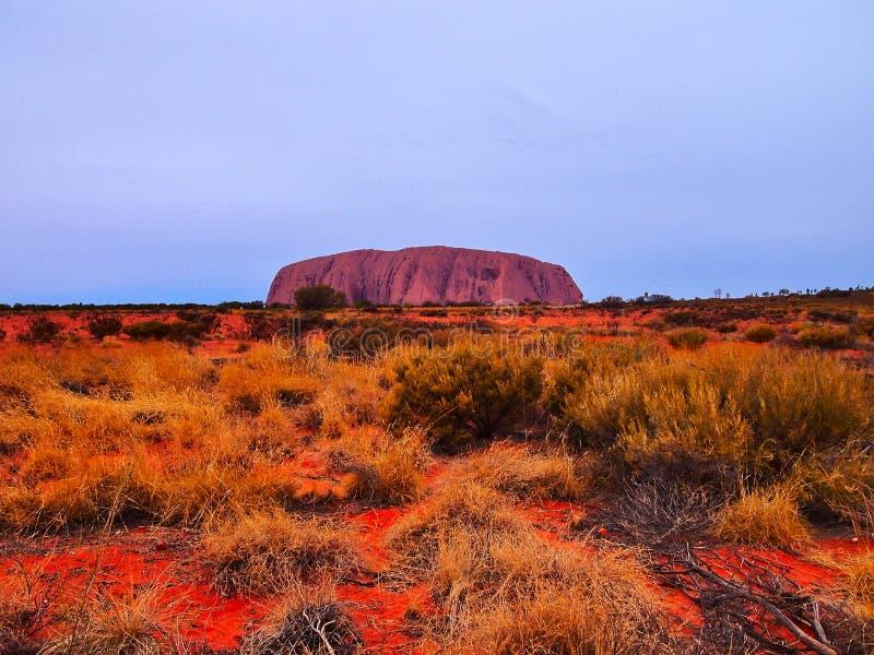 Uluru, утес Ayers, последнее освещение захода солнца, Австралия стоковые фото