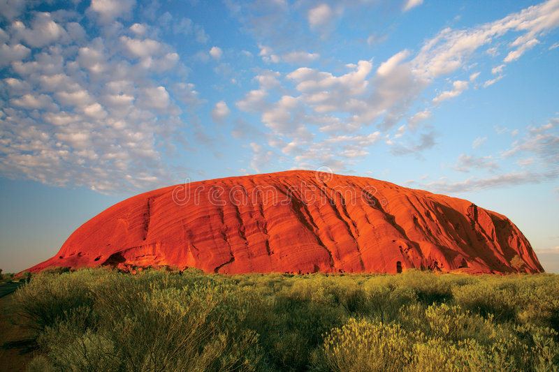 Uluru (Ayers Rock). Uluru early in the morning as the sun turns it bright red