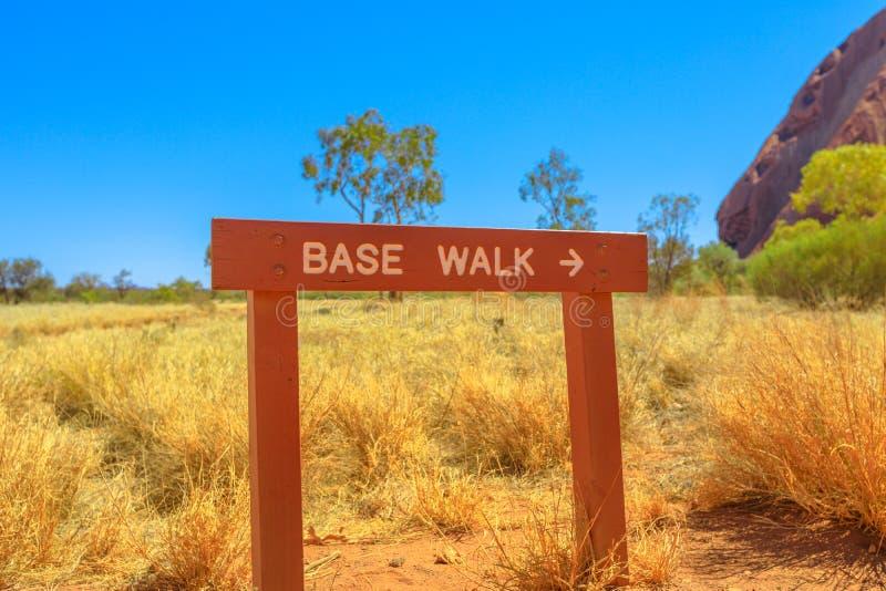 Uluru Base Walk sign. In sand path of Uluru-Kata Tjuta National Park, Northern Territory, Central Australia, outback landscape. The popular base walk is 10 km stock image