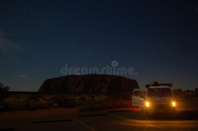 Uluru at night with car in front, ayers Rock, the Red Center of Australia, Australia royalty free stock image