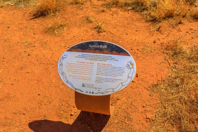 Kuniya walk sign. Uluru, Northern Territory, Australia - Aug 24, 2019: Kuniya walk sign in Uluru-Kata Tjuta National Park in Australian outback. This site is royalty free stock photo