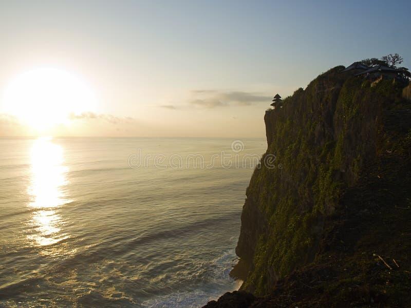 uluwatu de coucher du soleil de pura de luhur photographie stock libre de droits