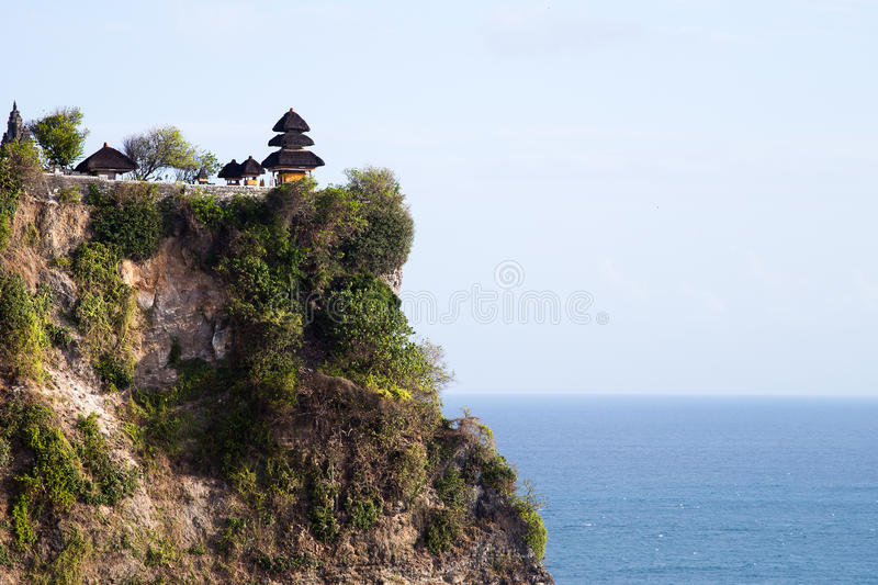 Uluwatu Temple, Bali. Uluwatu Temple, a Hindu Temple in Bali, Indonesia, standing over the cliff overseeing the Indian Ocean. This temple houses the Kecak Dance stock image