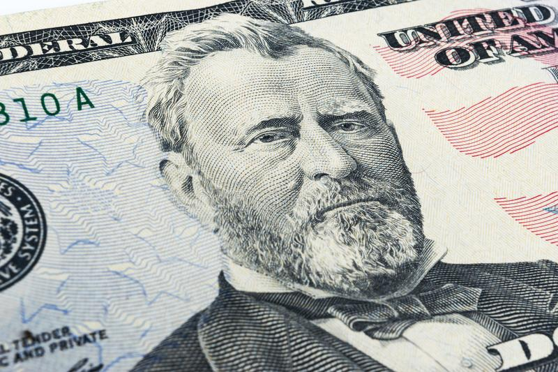 Ulysses S. Grant face on US fifty or 50 dollars bill macro, united states money closeup. Heap of 50 hundred dollar bills on money royalty free stock photos