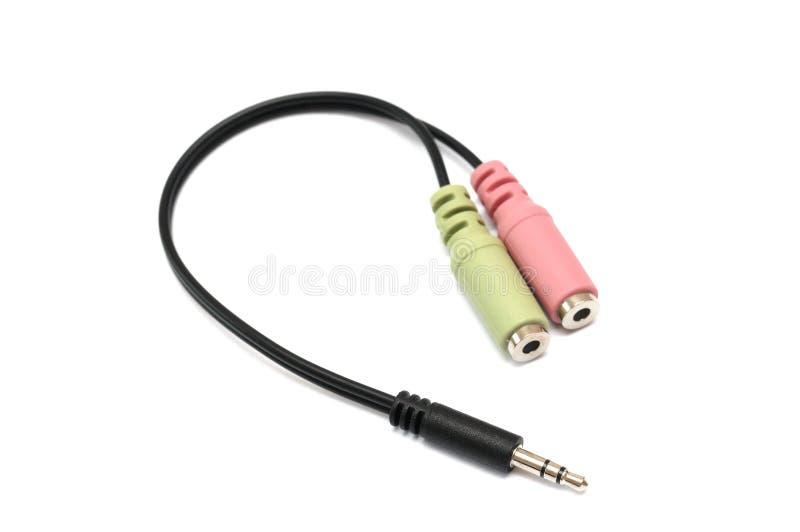 Um adaptador audio do cabo do computador fotografia de stock royalty free