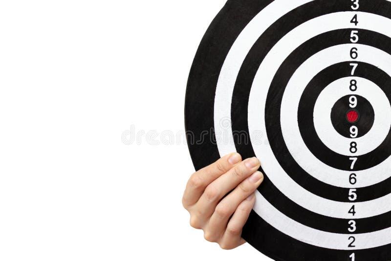 Um alvo nas mãos fêmeas fecha-se acima no fundo branco com o espaço da cópia, apontando e visando o conceito imagens de stock royalty free