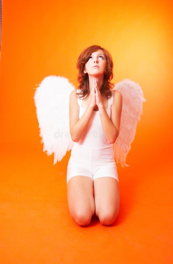 Um anjo que Praying fotografia de stock royalty free