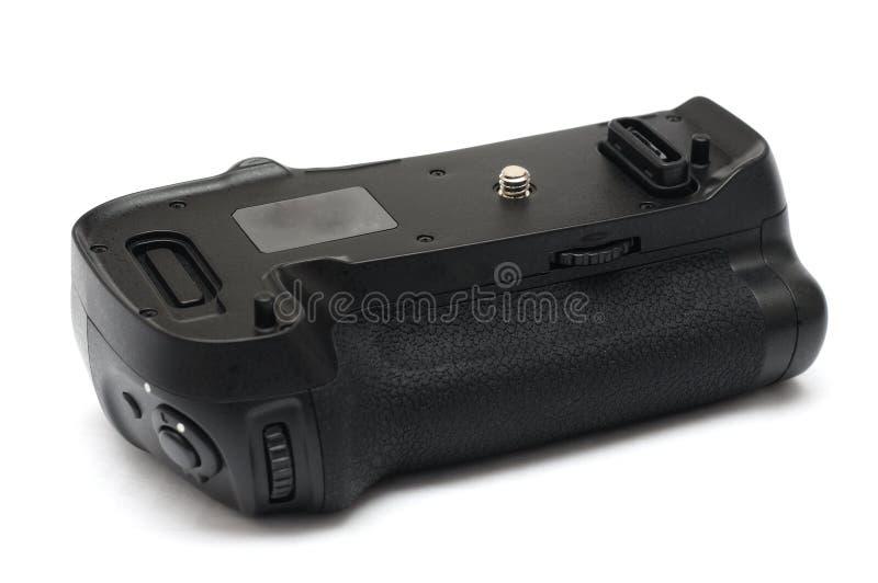 Um aperto vertical digital da bateria da câmera de reflexo da única lente foto de stock royalty free