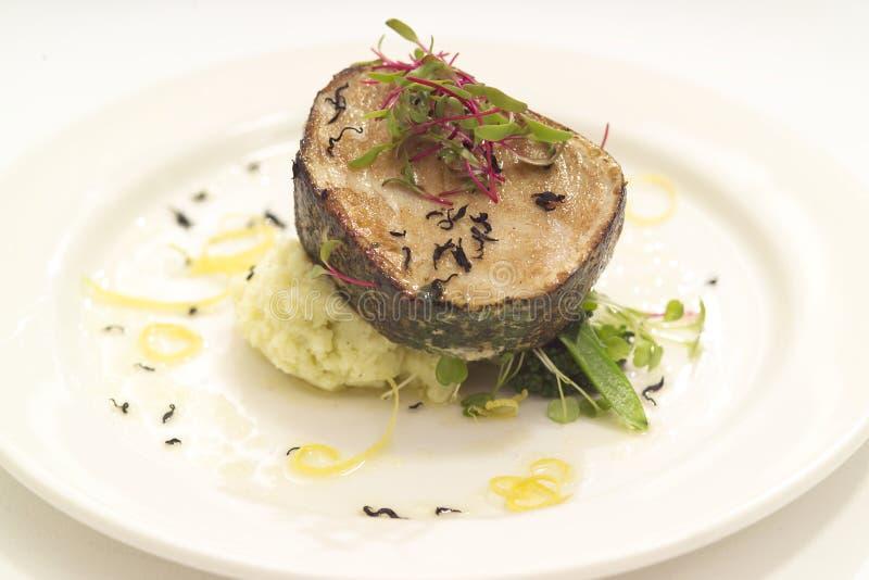 Um bife de peixes para o jantar imagens de stock royalty free