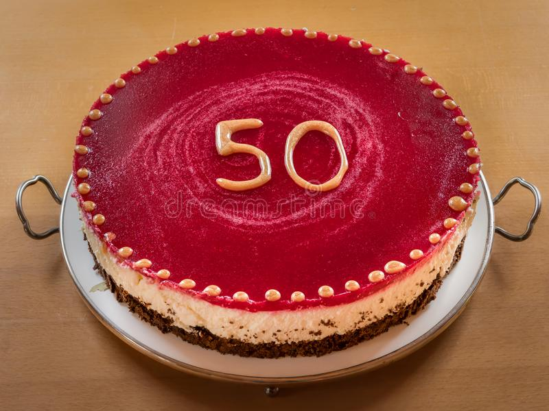Um bolo da semente de papoila para o 50th aniversário fotos de stock royalty free