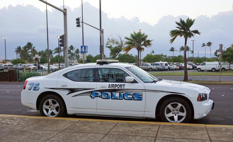- Um carro de polícia do aeroporto no aeroporto de Kahului foto de stock