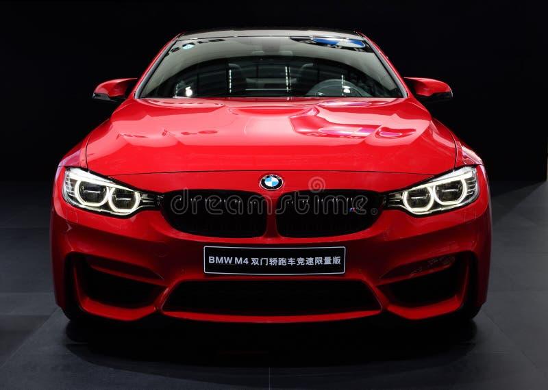 Um carro vermelho de BMW M4 imagem de stock