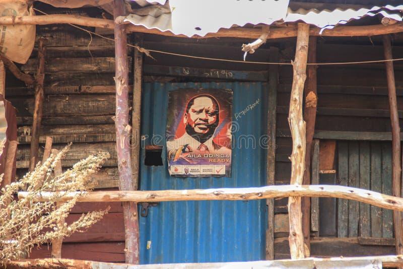 Um cartaz de um deputado local é um dos lugares os mais pobres em África fotos de stock