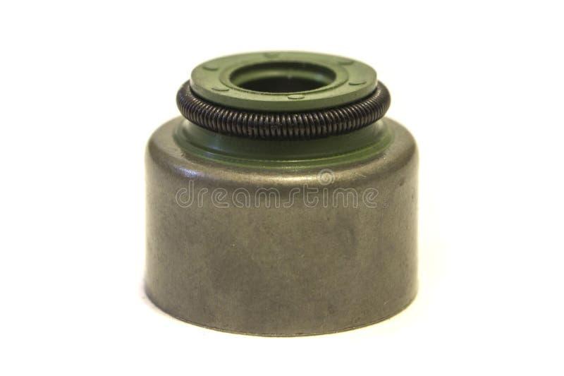 Um close up do tampão da haste de válvula no fundo branco imagem de stock