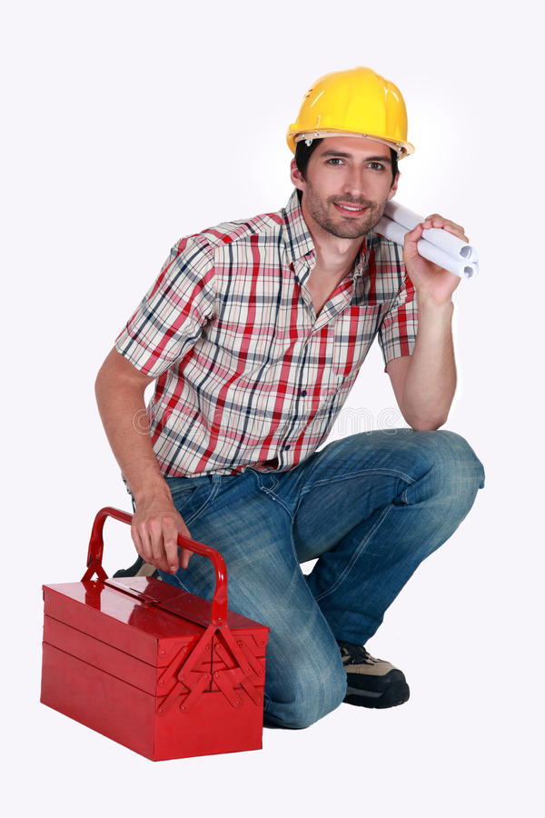 Um contramestre com uma caixa de ferramentas. imagens de stock