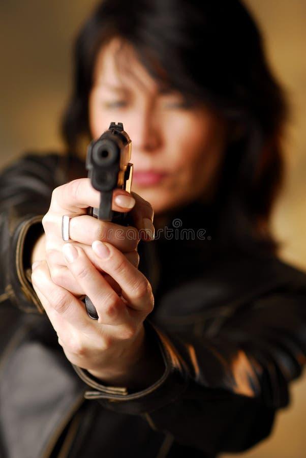 Um despedimento da mulher de um injetor imagens de stock