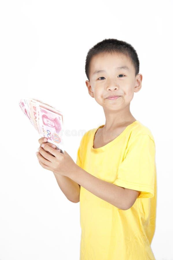 Um dinheiro da tomada da criança fotos de stock