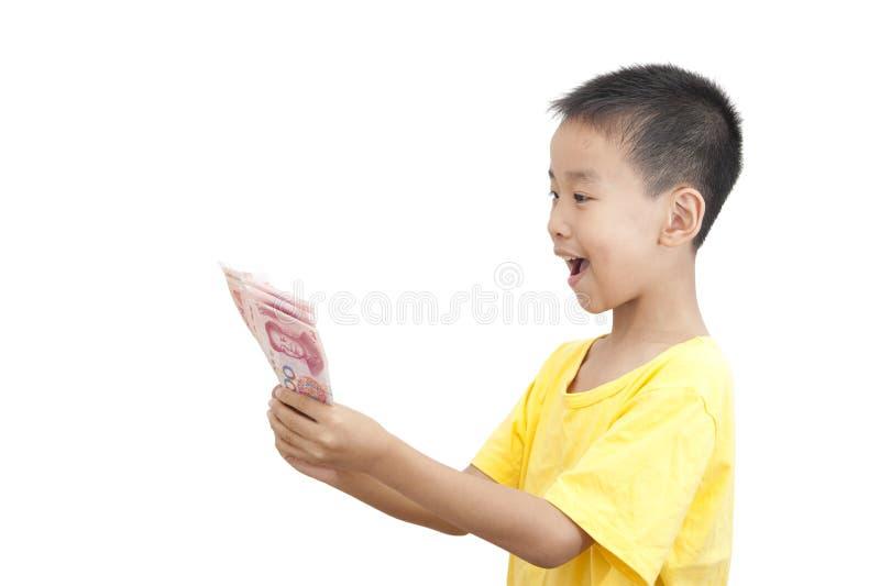 Um dinheiro da tomada da criança foto de stock