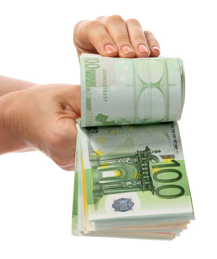 Um dinheiro está nas mãos fotografia de stock
