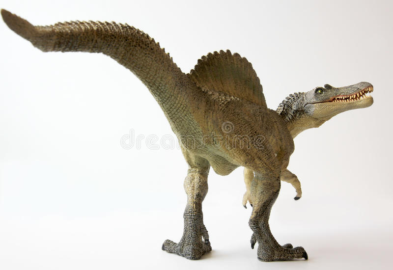 Um dinossauro de Spinosaurus com maxilas pasmado ilustração stock