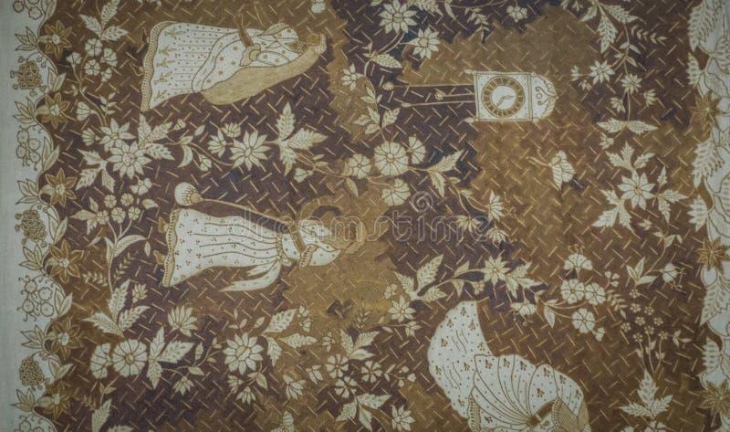 Um do teste padrão velho do Batik com ilustração das flores e dos povos com o foto a cores marrom e branco Pekalongan recolhido fotografia de stock royalty free