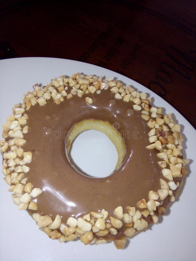 Um donnut saboroso do choco imagem de stock