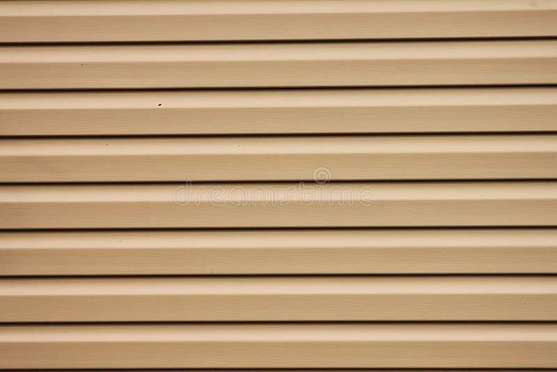 Um elemento marrom da parede da casa para o fundo, projeto imagem de stock