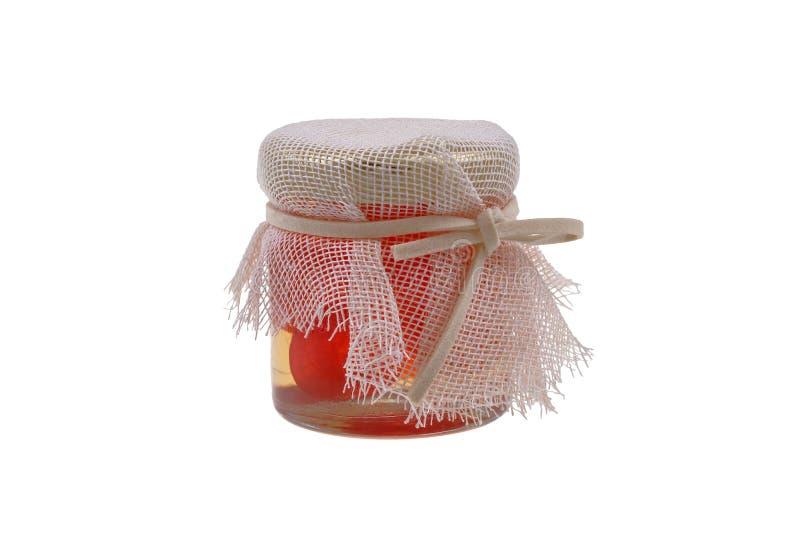 Um frasco diminuto do doce do kumquat, tradicional para a ilha de Corfu, Grécia Isolado no fundo branco imagem de stock royalty free
