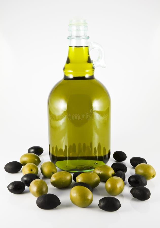 Um frasco do petróleo verde-oliva fotos de stock