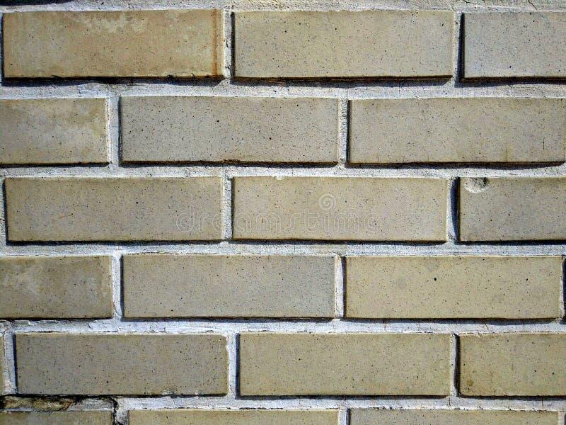 Um fundo da parede de tijolo fotografia de stock