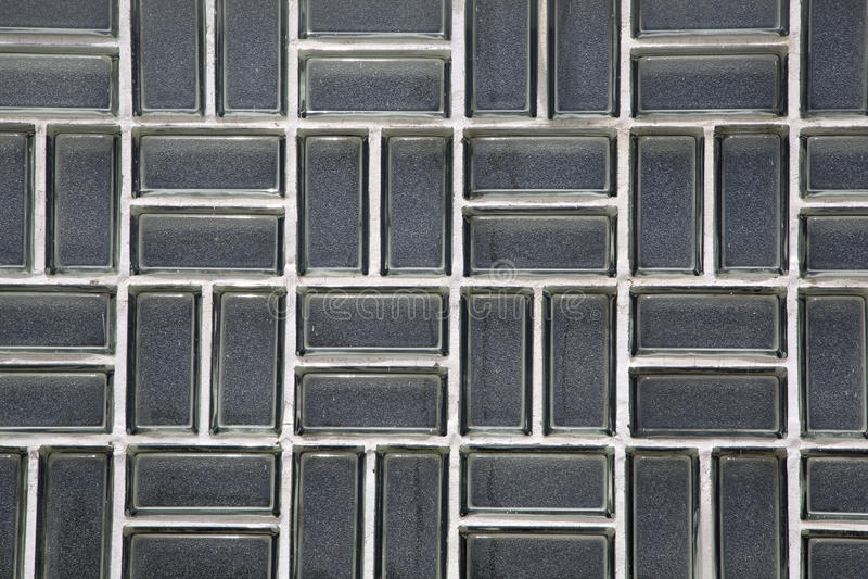 Um fundo e umas texturas da parede de vidro fotografia de stock