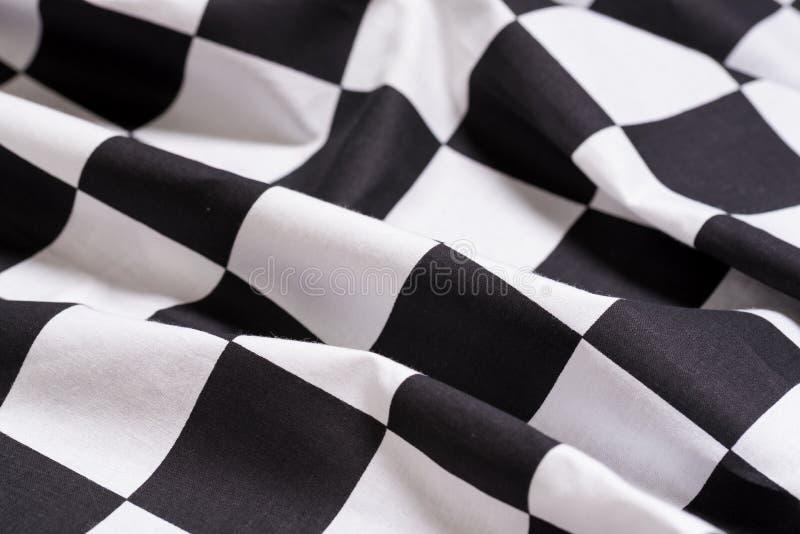 Um fundo quadriculado da bandeira - competência do motor - símbolo para ganhar fotos de stock