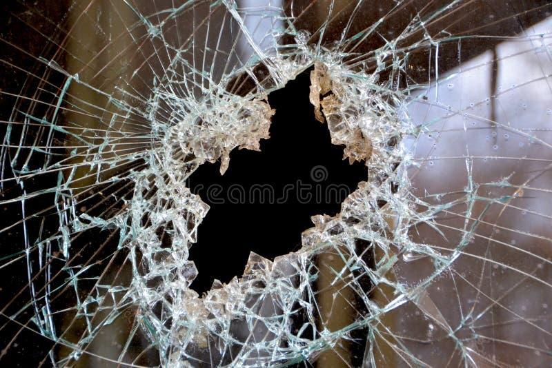 Um furo em uma janela imagens de stock royalty free