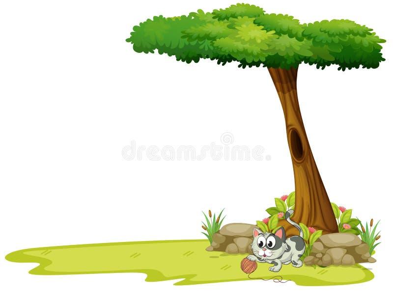 Um gato cinzento que joga com uma bola da corda sob uma árvore ilustração stock