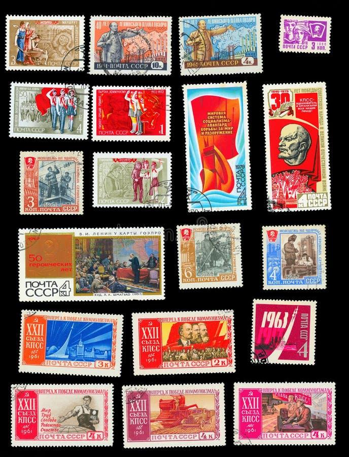 Um grupo de selos postais dos temas ideológicos de URSS imagem de stock royalty free