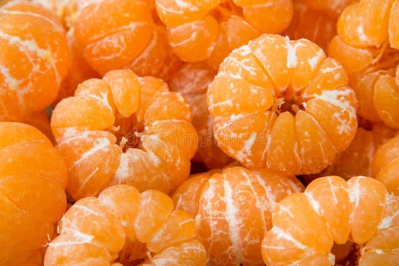 Um grupo de tangerinas alaranjadas descascadas da clementina texture o teste padrão b foto de stock royalty free
