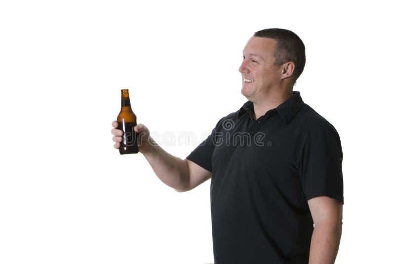 Um homem com cerveja foto de stock royalty free