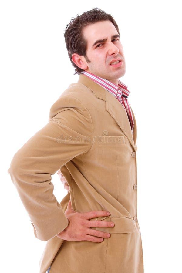 Um homem de negócio novo com uma dor lombar fotos de stock