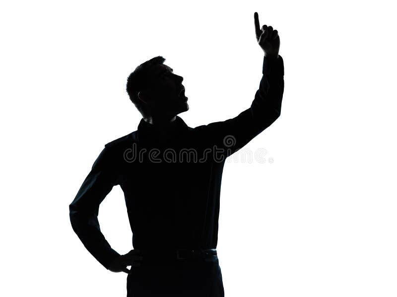 Um homem de negócio que aponta acima da silhueta surpreendida fotografia de stock royalty free