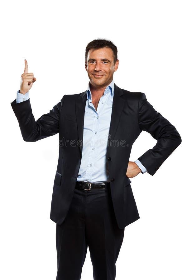 Um homem de negócio que aponta acima do dedo imagem de stock royalty free