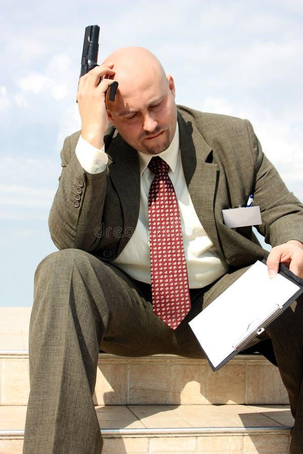 Um homem de negócios com um injetor imagem de stock